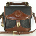 Authentic Dooney and Bourke All Weather Leather R703 Vintage Square Carrier in black and British Tan