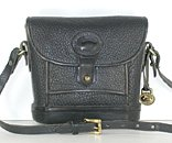 Authentic Dooney and Bourke All Weather Leather Mini Dover Case in black and British Tan