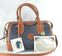 Authentic Dooney and Bourke All Weather Leather R90 Small Gladstoner Bag navy and British tan