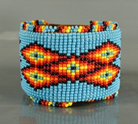 Authentic Native American tufa cast sterling silver and coral kachina leather cuff by Navajo artist Lee Begay