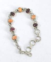 New Old Stock Inlay bracelet Sterling Silver and orange and purple spiny oyster link bracelet by Navajo artist Eugene Crawford