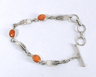 New Old Stock Inlay bracelet Sterling Silver and orange and purple spiny oyster link bracelet by Navajo artist Teddy Goodluck, Jr.