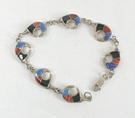 New Old Stock Inlay bracelet Sterling Silver and orange and purple Medicine Bears link bracelet by Navajo artist Calvin Begay