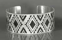Authentic Native American Sterling Silver rug pattern cuff bracelet by Navajo silversmith Roland H. Begay