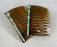 pair of hair combs with turquoise needle point inlay
