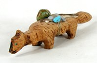 vintage wooden wolf fetish carving with medicine bundle of turquoise and feather