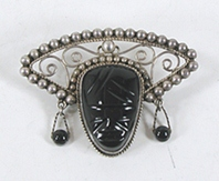 Vintage Mexican sterling silver black onyx mask pin