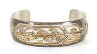 Authentic Native American Sterling Silver and Gold Storyteller Bracelet 6 3/4 inch by Navajo silversmith Lawrence Delgarito