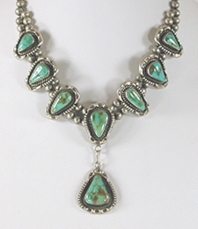 Vintage sterling silver bead necklace with eight turquoise stones