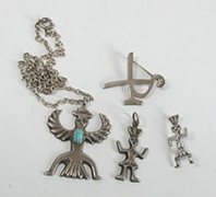 wo sterling silver pendants and two sterling silver pins