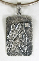 Authentic Native American Sterling Silver Wolf pendant by Navajo silversmith Monty Claw